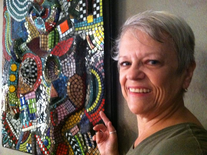 Clearwater mosaic glass artist Carole Haberkorn next to her self-portrait.