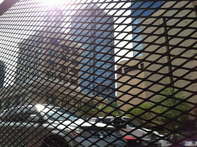 Tampa City Hall as seen through the steel fencing that surrounded government buildings during the Republican National Convention.