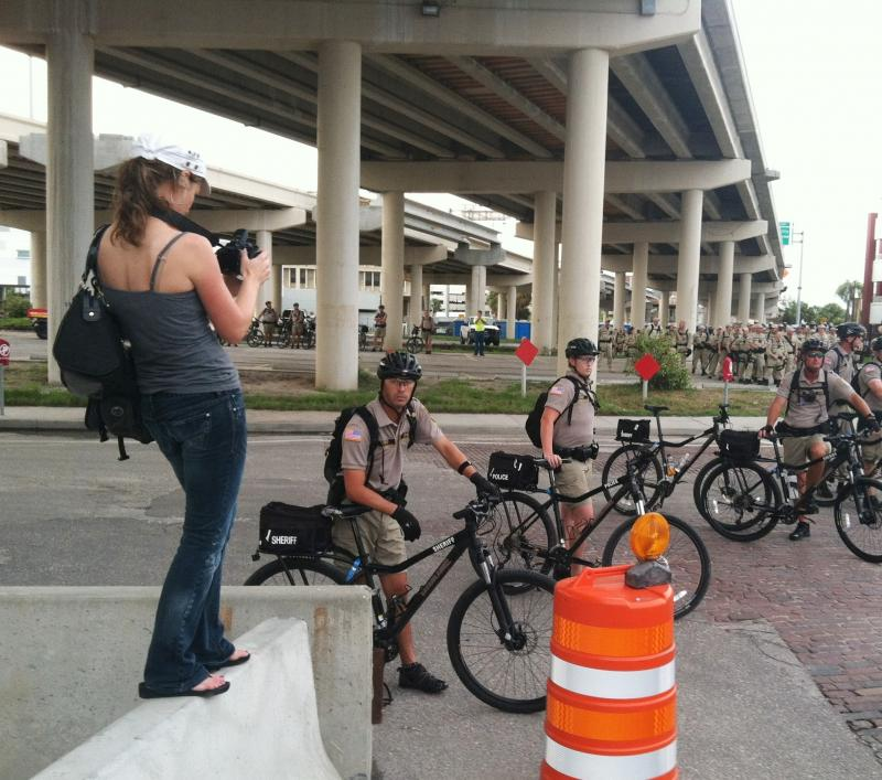 Reporter/videographer Sarah Pusateri shoots video at a protest