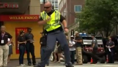 An officer in Charlotte shows off his dance moves while directing traffic during the Democratic National Convention.