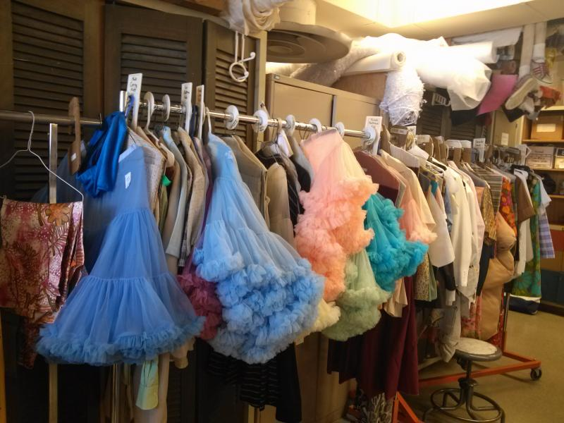 "Some of the dozens of costumes for ""Hairspray"" in the USF Costume Shop."