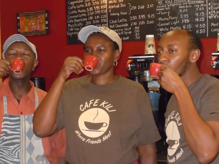 Cafe Kili owner Rose Waruinge enjoys a cup o' joe with husband Patrick, left, and son Anthony.