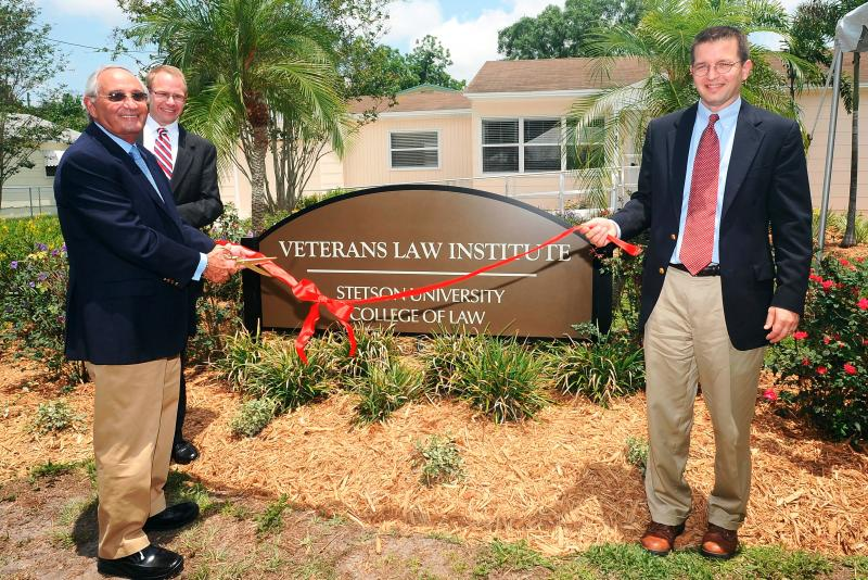 Judge Raphael Steinhardt (left), Institute director Michael Allen (middle), and Law Interim Dean Royal Gardner(right) cut the ribbon at Stetson's new Veterans Law Institute in Gulfport. May 31, 2012