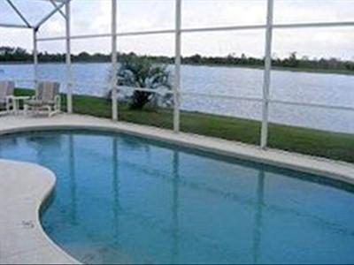 """Librarian Marcee M. Challener, John F. Germany Library: """"I love to read on my pool deck overlooking my back yard, which is on a small lake. It's also my favorite place to read print or form my iPad or do crossword puzzles."""""""