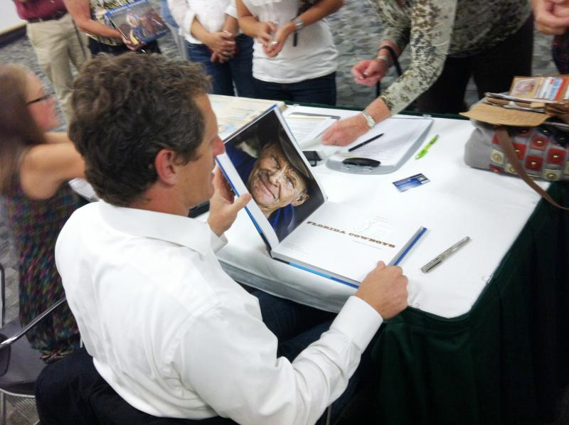 Carlton Ward Jr. autographs copies of his book at a recent appearance at USF St. Petersburg