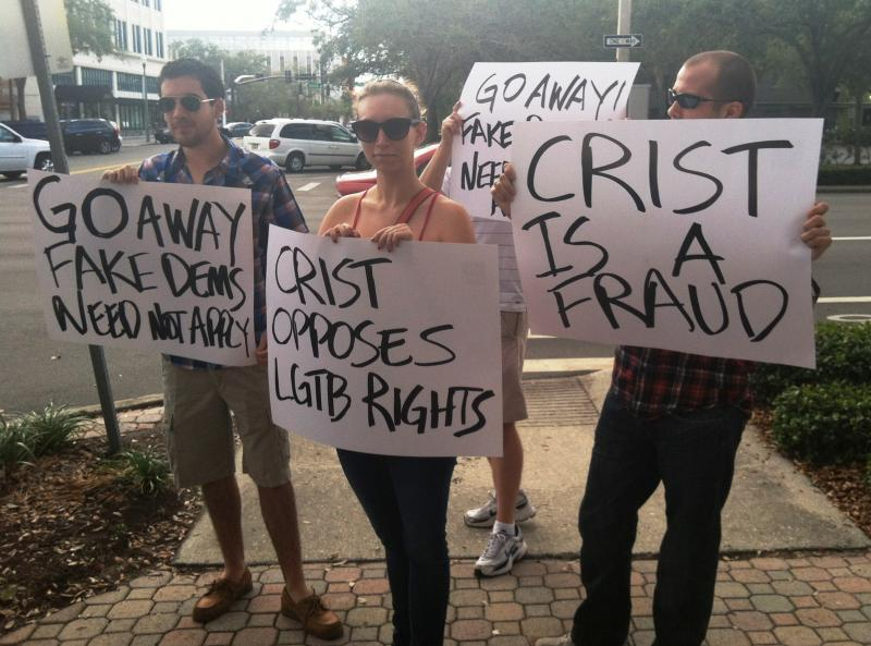 "Protestors claim Crist is not a ""true"" Democrat"