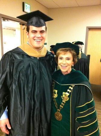 MBA Graduate Chaz Hine and USF President Judy Genshaft