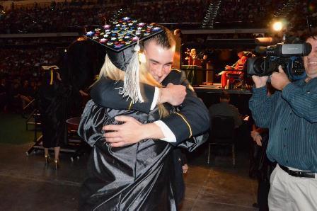 Taylor Livingston hugs sister Cassie Ladika