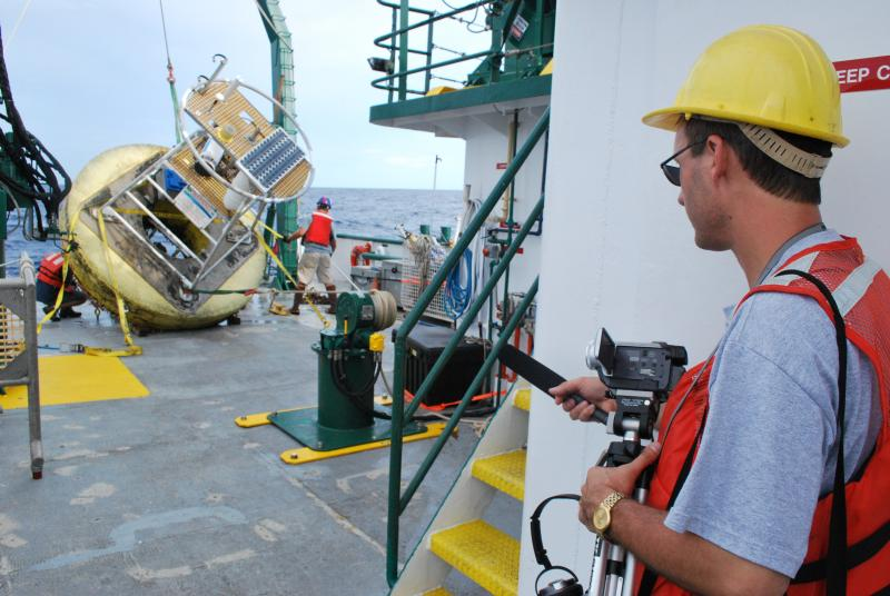 WUSF reporter Mark Schreiner on the deck of the R/V Weatherbird II on a 2010 research cruise