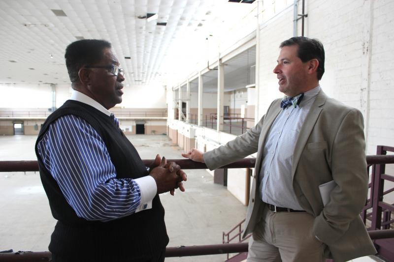 Clarence Fort, left, reminisces at the Fort Homer Hesterly Armory with Rodney Kite-Powell of the Tampa Bay History Center. Fort, now 74, was 21 when Dr. Martin Luther King Jr. spoke at the armory in 1961.