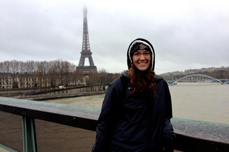 USF junior tuba player/band captain Melissa Adamsposes in front of the Eiffel Tower on HOT's daytrip to Paris