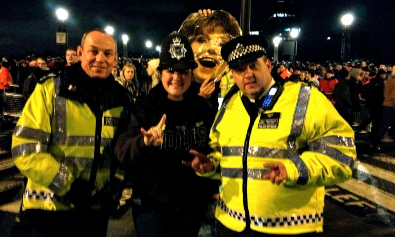 USF sophomore & trombone player/drum major Danielle Batcheller poses with London police & President Genshaft's likeness on Lambeth Bridge on New Year's Eve