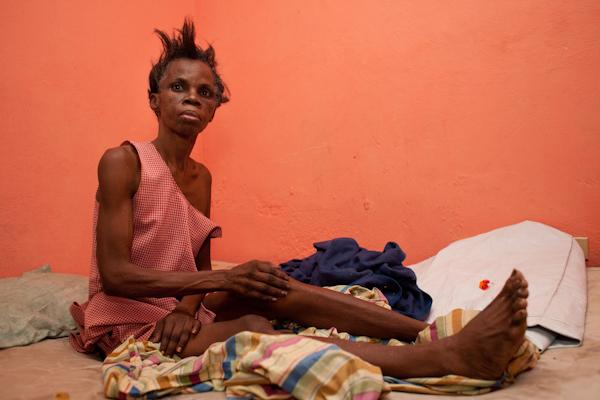 Fabienne's mother sits up in bed. She died in December.