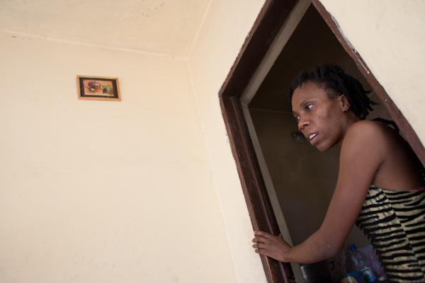 Fabienne in the doorway of the part of her home where she cooks.
