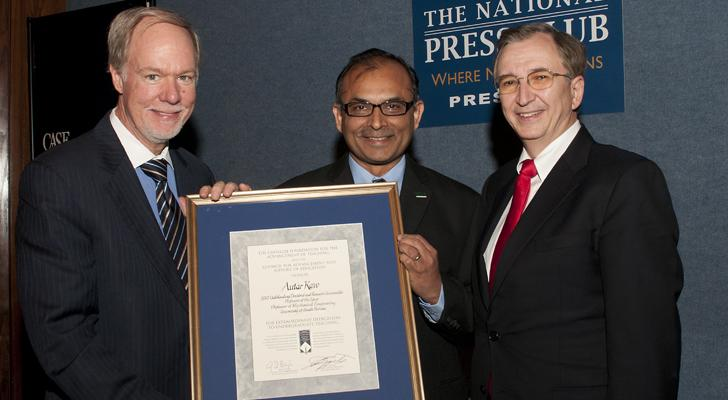 USF Professor Autar Kaw (center) with CASE President John Lippincott (left) and Carnegie Foundation President Anthony S. Bryk