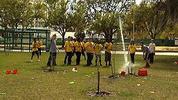 USF Engineering students launch water rockets for younger students at USF Engineering Expo