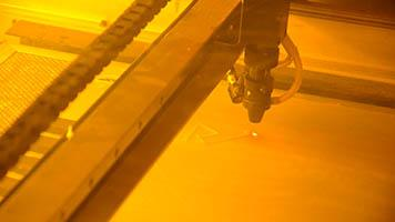 A laser cuts a shape-shifting surface component
