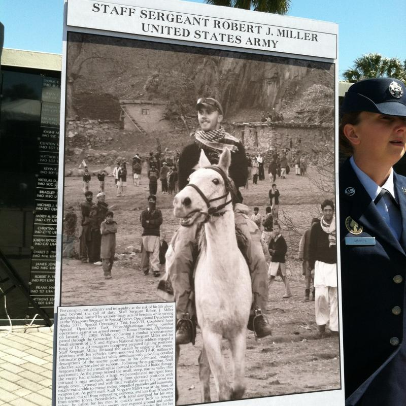 "A poster of Staff Sergeant Robert ""Robbie"" Miller, a Green Beret and recipient of the Congressional Medal of Honor, who lost his life battling insurgents but saved seven teammates and 15 Afghan soldiers."