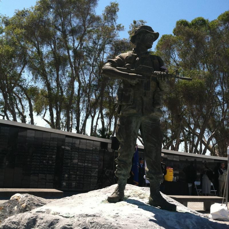 A bronze statue of a Speical Forces member stands vigil at the memorial.