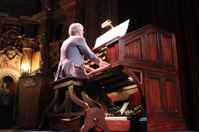 Volunteer Bob Courtney plays the 'Mighty Wurlitzer Theatre Organ' before the start of the show.