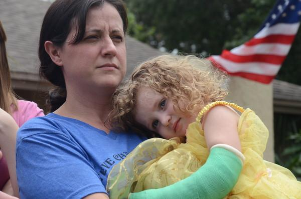 Nicole Nugent holds her daughter, Ireland, outside of their Palm Harbor home