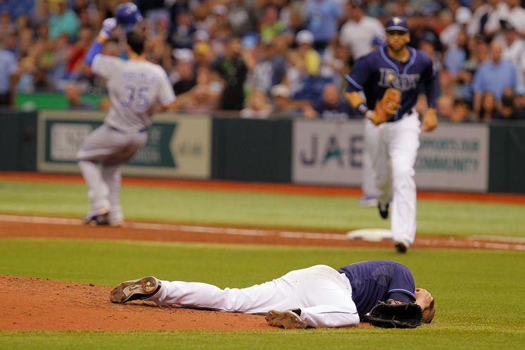 Rays pitcher Alex Cobb lies on the ground after being struck by a line drive Saturday.