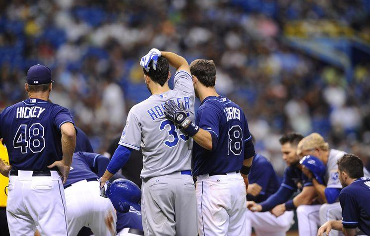 The Rays' Ben Zobrist comforts the Royals' Eric Hosmer, whose line drive struck Cobb.