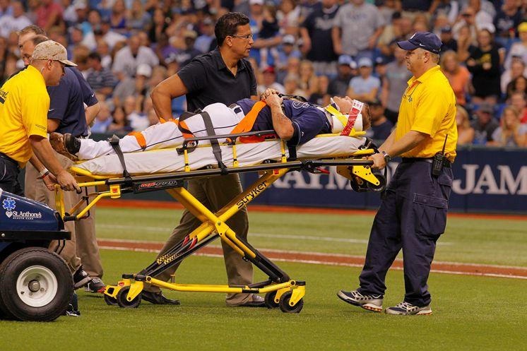 Cobb is stretchered off Tropicana Field.