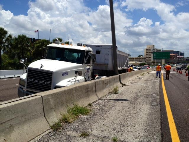 Looking north at the tractor trailer at rest in the emergency lane of southbound I-275 at Tampa's West Shore exit.
