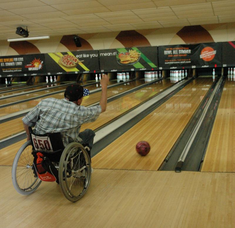 A Veteran bowls at the 32nd National Veterans Wheelchair Games.