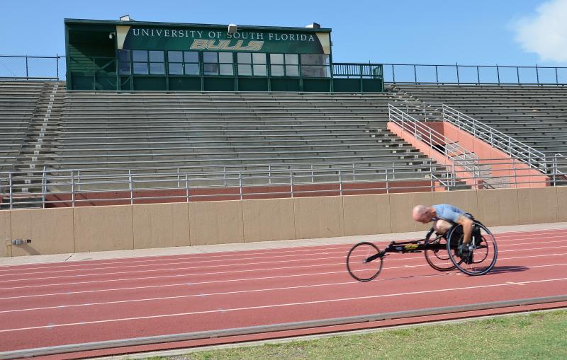 Dwayne Scheuneman training for the 100 and 200 meter wheelchair sprints.