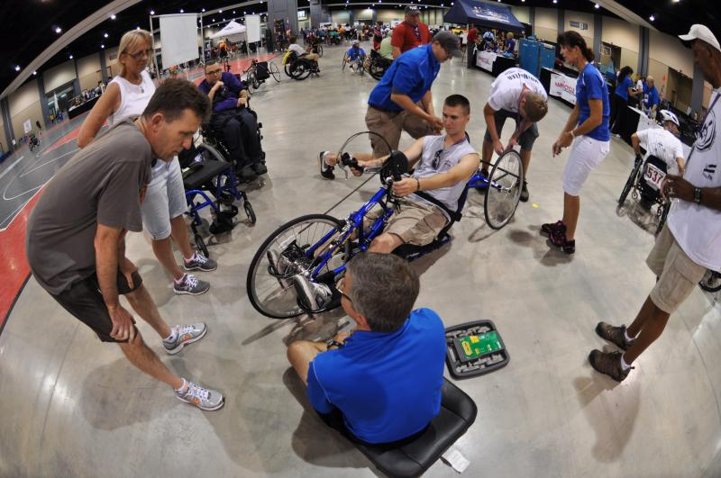 Handcycle tune up at the 32nd National Veterans Wheelchair Games.