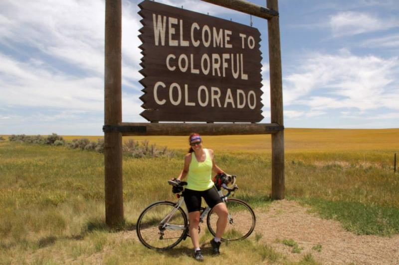 Kiersten Downs stops to document entering Colorado on her journey across the USA.