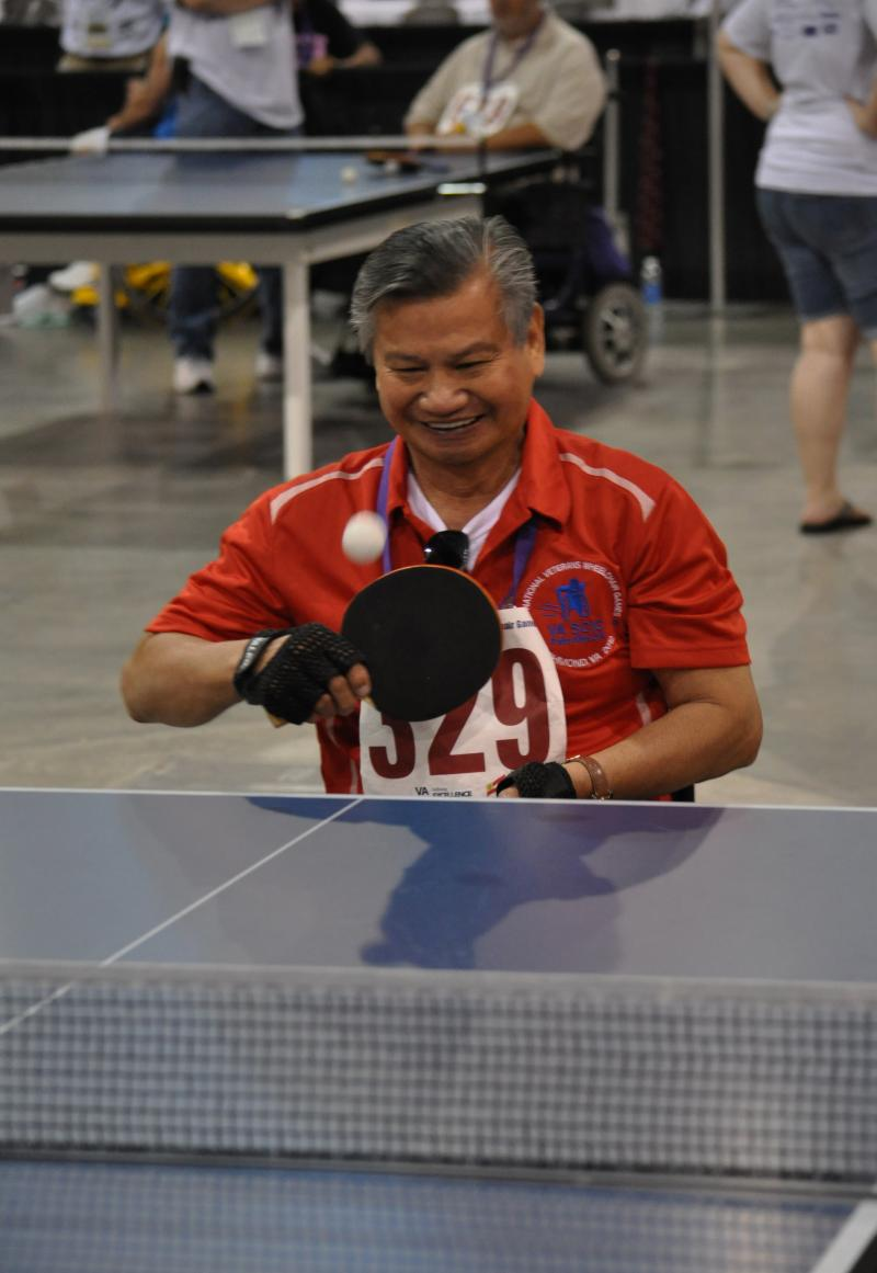 Roy Aquino plays table tennis at the 32nd National Veterans Wheelchair Games.