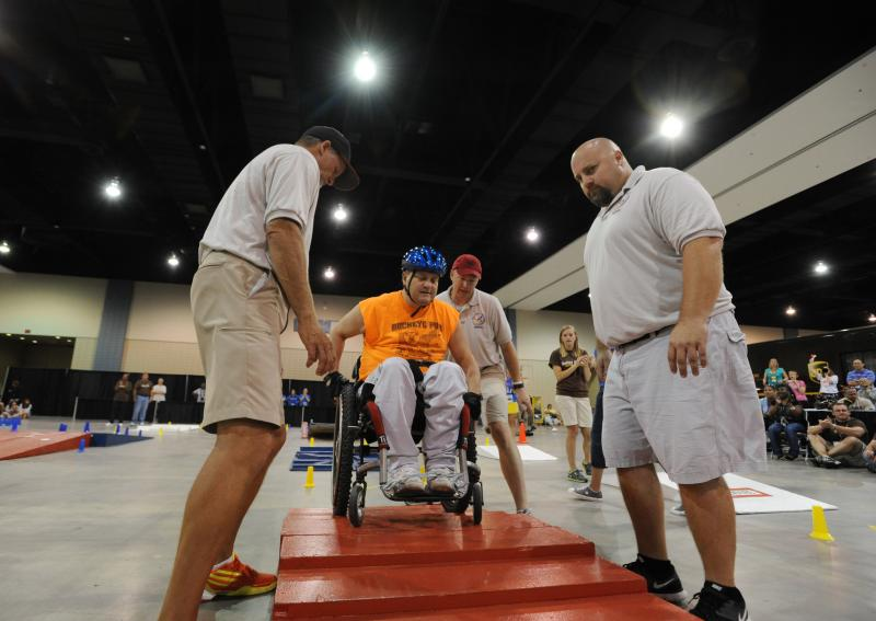 A Veteran navigates the slalom course at the 32nd National Veterans Wheelchair Games.