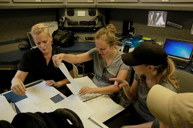 USF asst. prof. of anthropology Erin Kimmerle discusses excavation plans with students (l-r) Meredith Tise, Ashley Maxwell and Cristina Kelbaugh.