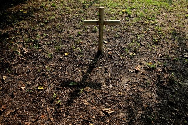 A metal cross marks a grave in the Boot Hill cemetery.