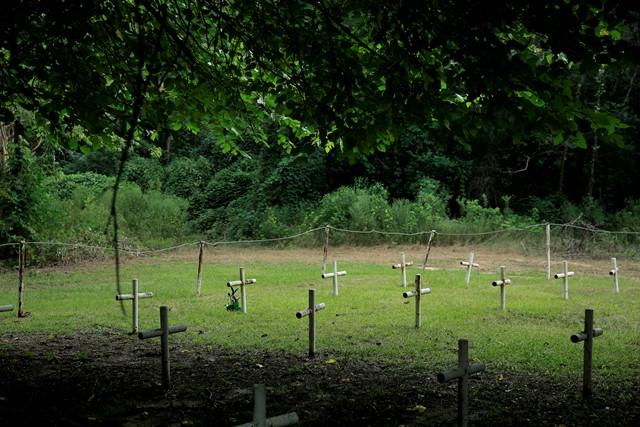 31 metal crosses mark possible graves in the Boot Hill cemetery.