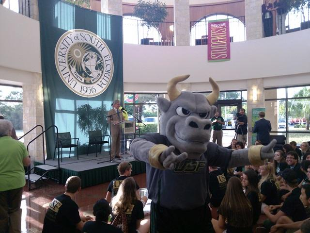 Rocky the Bull poses while USFSM Regional Chancellor Arthur Guilford prepares to speak