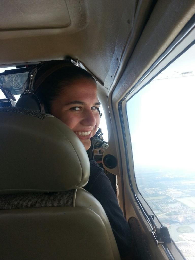 Hoping to become a pilot, Jacqueline Parker is all smiles during one of her Orientation flights with the Civil Air Patrol.