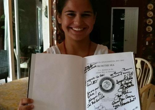 Jacqueline Parker holds a treasured possession from ther summer camp at Quantico, The U.S. Marines in Afghanistan. She got it signed by the Marine Commandant.