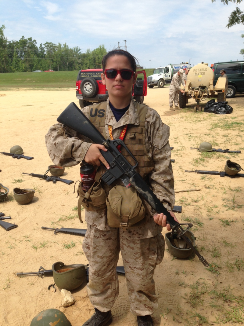 "Jacqueline Parker holding a ""dummy"" M16 at the Marine summer leadership camp 2013."