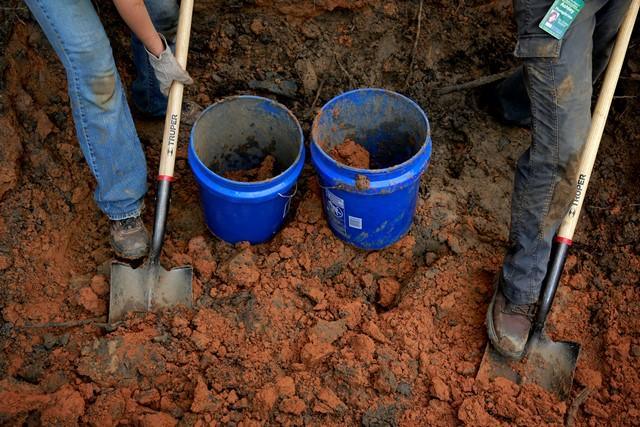 USF anthropologists begin exhuming suspected graves in the Boot Hill cemetery Saturday.
