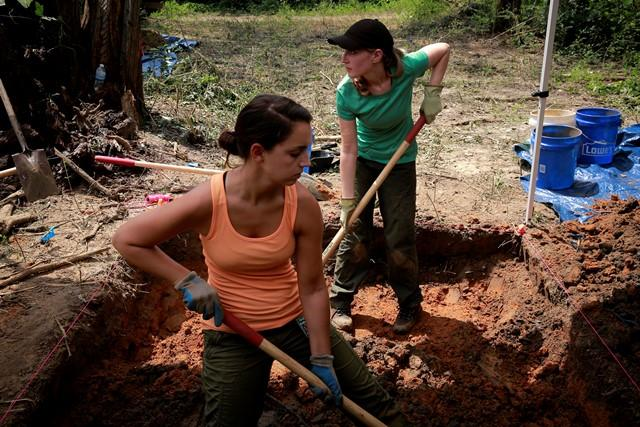 USF masters student Cristina Kelbaugh (l) & doctoral student Ashley Maxwell dig at the Boot Hill cemetery Saturday.