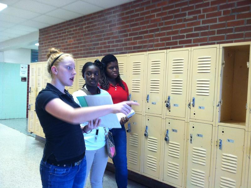 Eighth-grader Kaylea Stephens (left) is a member of the Student to Student program at Monroe. Here she shows around a new student and parent.