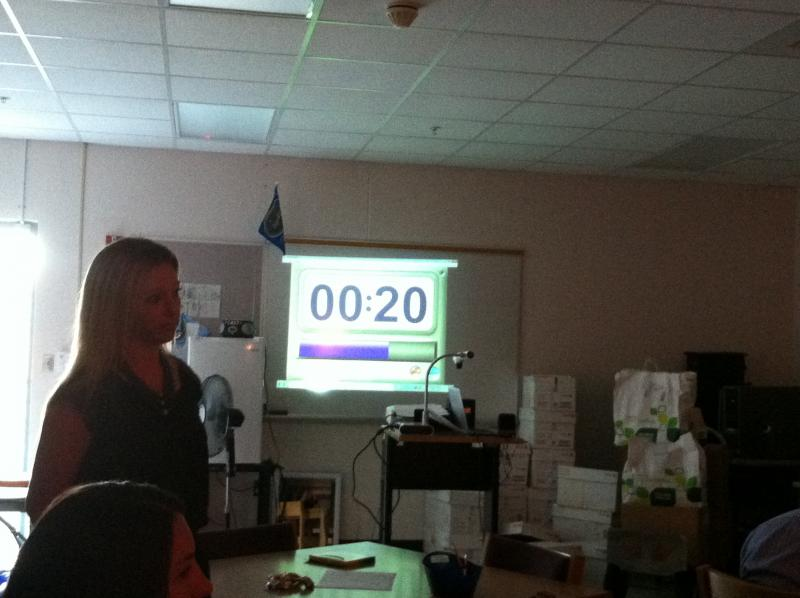Teachers getting in-service training on use of the interactive whiteboard.