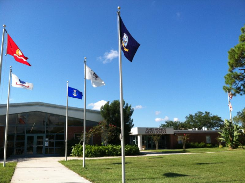 Flags for each of the military branches of service fly outside of Monroe Middle School, the public school for children living on MacDill Air Force Base.