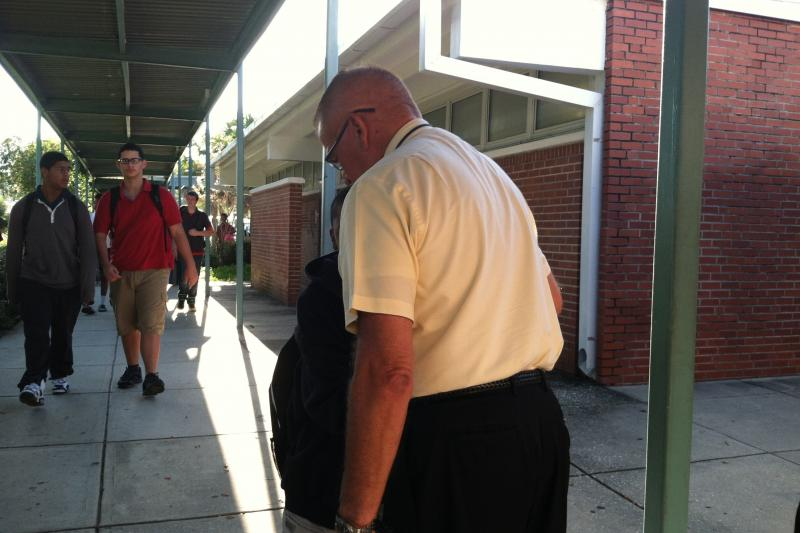 Principal Hart interacts with Monroe students as they head to class.