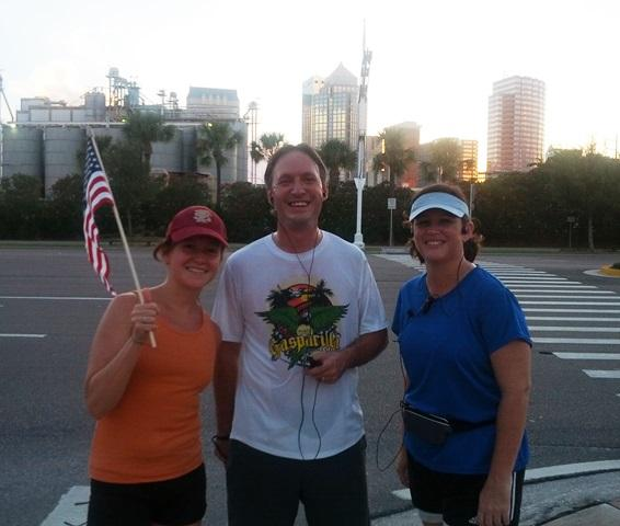 WUSF's Mark Schreiner poses with fellow runners Rachel Gaete (left) and Anne Jones