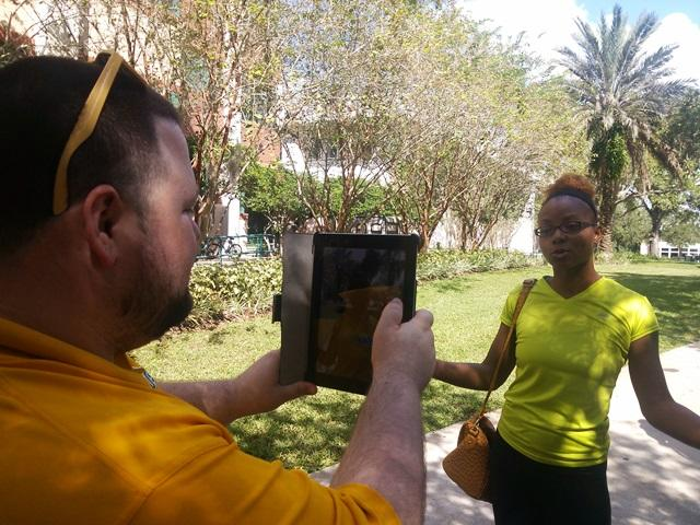USF Student Govt. Senator Christopher Cano (left) shoots USF student Shaheedra Johnson's video message to state legislators